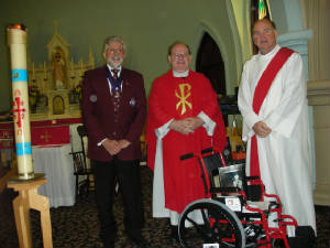 KOFC4949 2011-2012 Wheelchair Prject reaised funds for 47 wheelchairs, GK Guenter A. Rieger, Father Dale and Deacon Paul Murphy