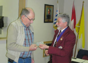 KOFC4949; Sir Knight Ralph Hounslow receives his Life Membership from Grand Knight Guenter A. Rieger