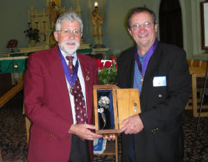 KOFC4949 GK Guenter A. Rieger receives the Silver Rose from GK BernieLutes