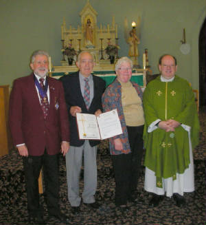 KOFC 4949 Val and Pat Dorigo celebrating 50 years of marriage. Left. GK Guenter A. Rieger, Val and Pat Dorigo, Father Dale Normandeau. Click on picture to watch video